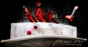 viinapullo ruumisarkussa